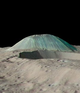 Perspective view of the Ceres mountain Ahuna Mons in false color derived from Dawn's framing-camera data. The bluish color of the mountain's flanks probably represents a compositional change. Ahuna Mons is 2.5 miles tall and 10.5 miles wide (4 by 17 kilometers).