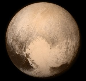 Pluto nearly fills the frame in this image from NASA's New Horizons spacecraft, taken on July 13, 2015, when the spacecraft was 476, 000 miles (768, 000 km) from the dwarf planet's surface. This is the last and most detailed image sent to Earth before the spacecraft's closest approach to Pluto on July 14. The color image has been combined with lower-resolution color information from the Ralph instrument that was acquired earlier on July 13. This view is dominated by the large, bright feature informally named the 'heart, ' which measures around 1, 000 miles (1, 600 km) across. The heart's diameter is about the same distance as from Denver to Chicago, in America's heartland. The heart borders darker equatorial terrains, and the mottled terrain to its east (right) are complex. However, even at this resolution, much of the heart's interior appears remarkably featureless-possibly a sign of ongoing geologic processes. Image credit: NASA / Johns Hopkins University Applied Physics Laboratory / Southwest Research Institute.