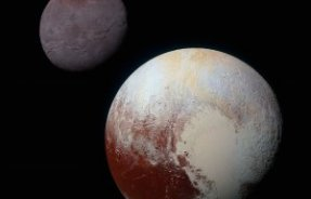 This composite image shows Pluto (lower right) and Charon (upper left). The image combines blue, red and infrared images taken by the spacecraft's Ralph/Multispectral Visual Imaging Camera. Image credit: NASA / Johns Hopkins University Applied Physics Laboratory / Southwest Research Institute.