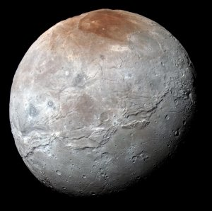 This impressive view of Charon was captured on July 14, 2015. Charon's color palette is not as diverse as Pluto's; most striking is the reddish north (top) polar region, informally named Mordor Macula. Image credit: NASA / Johns Hopkins University Applied Physics Laboratory / Southwest Research Institute.